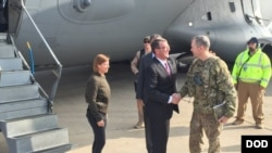FILE - Army Lt. Gen. Sean MacFarland greets U.S. Defense Secretary Ash Carter after arriving in Baghdad, Dec. 16, 2015. MacFarland says end of IS is 'a matter of time' and more help.""