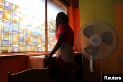 """Nigerian ex-prostitute """"Beauty"""" (a pseudonym), poses in a social support center for trafficked girls near Catania in Italy."""