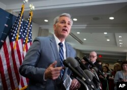 FILE - House Republican Minority Leader Kevin McCarthy of California speaks to reporters at the Capitol in Washington, Jan. 8, 2019.