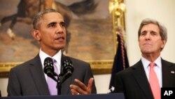 美國國務卿約翰克里(右)與美國總統奧巴馬15年2月11日資料照。