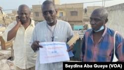 Des réfugiés mauritaniens à Guinaw Rails dans la banlieue de Dakar, au Sénégal, le 23 juin 2021. (VOA/Seydina Aba Gueye)