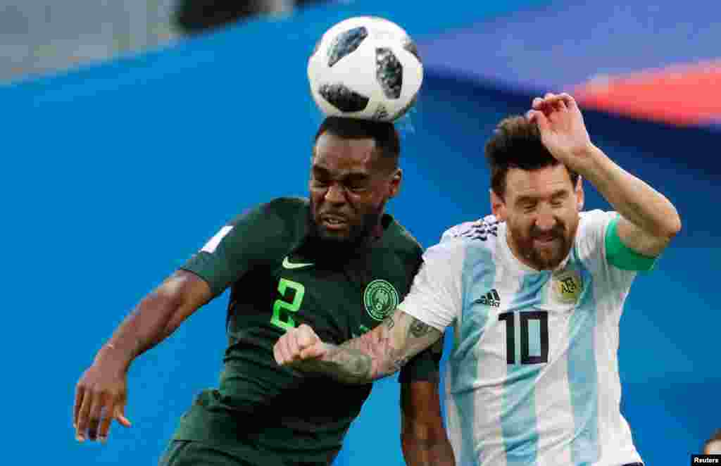 Brian Idowu of Nigeria (left) and Argentina's Lionel Messi fight for the ball during the group D match between Argentina and Nigeria, during the 2018 soccer World Cup at the St. Petersburg Stadium.