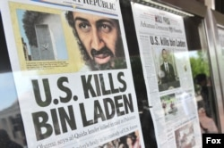 FILE - Front-page headlines that announce the death of al-Qaida terror leader Osama bin Laden are seen at the Newseum in Washington, May 2, 2011.