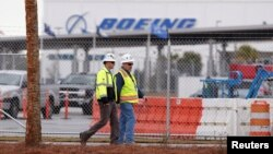 Workers walk through the Boeing South Carolina Plant while voting started on Wednesday whether the plant will be unionized in North Charleston, South Carolina, Feb. 15, 2017.
