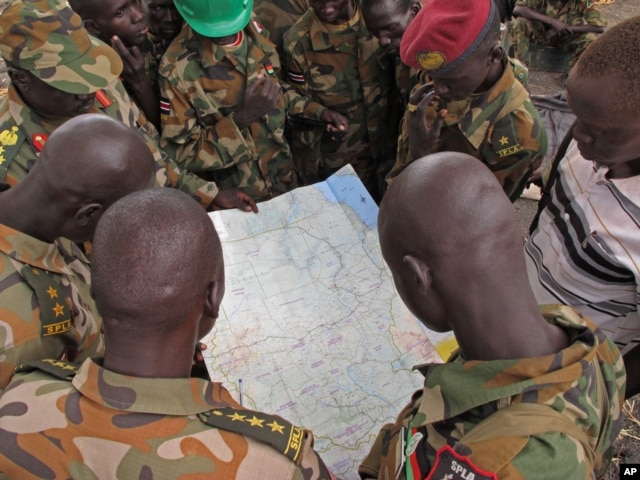 FILE - Soldiers from the Sudan People's Liberation Army (SPLA) are seen examining a map in Pana Kuach, Unity State, South Sudan.