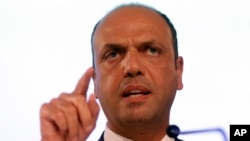 FILE - Italian Interior Minister Angelino Alfano speaks at a press conference during an informal meeting on Justice and Home Affairs in Milan, Italy, July 2014.