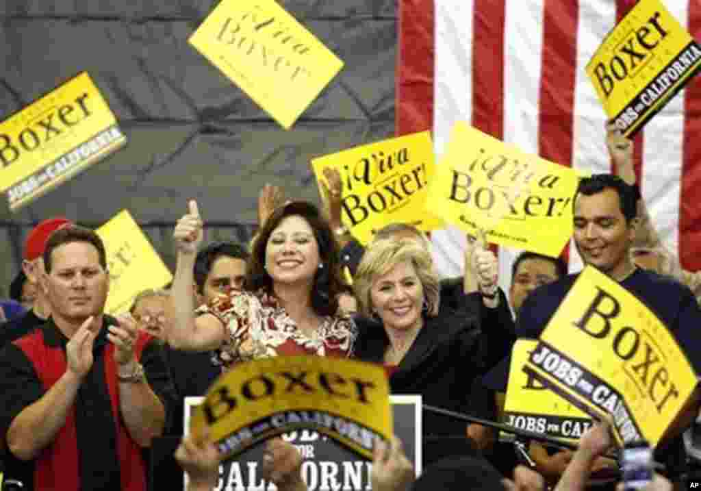 U.S. Secretary of Labor Hilda Solis, left, and U.S. Sen. Barbara Boxer, D-Calif. address get-out-the-vote volunteers at the International Association of Firefighters Local 1014, 31 Oct. 2010, in El Monte, California. (AP Photo)