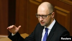 Ukrainian Prime Minister Arseny Yatseniuk, shown addressing legislators in Kyiv in December, says IMF officials are pressing hard for implementation of promised reforms by the government, including overhauling the state gas company.