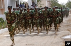 FILE - Somali soldiers march during the 54th anniversary of Somali National Army Day in Mogadishu, Somalia, April,12, 2014.