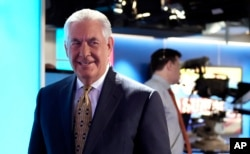 Secretary of State Rex Tillerson leaves the set following a television interview with Chris Wallace, the anchor of FOX News Sunday, in Washington, Aug. 27, 2017.