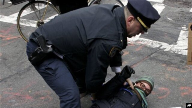 A policeman arrests a Occupy Wall Street protester in New York, Thursday, Nov. 17, 2011