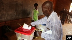 FILE - A man casts his ballot during elections in Bangui, Central African Republic, Dec. 30, 2015.