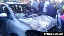 One of the cars burnt down by a blaze that gutted a derelict building in Zimbabwe's second city, Bulawayo.