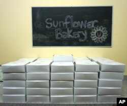 Sunflower Bakery's desserts are boxed and ready to be delivered.