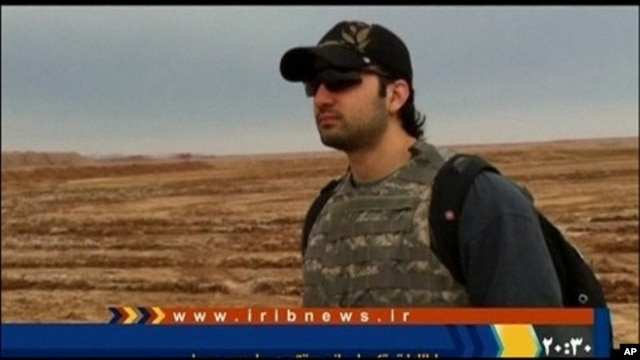 Iranian-American Amir Mirza Hekmati, who has been sentenced to death by Iran's Revolutionary Court on the charge of spying for the CIA, stands in this undated still image taken from video in an undisclosed location made available to Reuters TV, January 9,