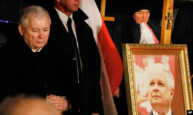 FILE - Jaroslaw Kaczynski leader of ruling party Law and Justice Party attends a remembrance ceremony for the 2010 plane crash that killed Poland's President Lech Kaczynski and 95 others in Smolensk, in front of the Presidential Palace in Warsaw, Poland, Thursday, March 10, 2016.