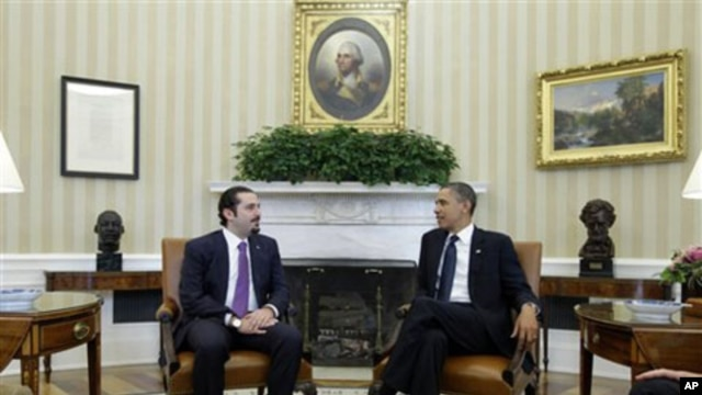 President Barack Obama meets with Lebanese Prime Minister Saad Hariri in the Oval Office of the White House in Washington, 12 Jan 2011