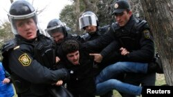 "Police officers detain a man during a rally in Baku, Azerbaijan, Jan. 26, 2013. In addition to arresting 20 activists in 2016 on ""spurious charges,"" the Azeri government has severely limited the ability of independent groups to function, a news Human Right Watch report says."