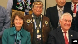 U.S. Secretary of State Rex Tillerson (seated right) and U.S. Sen. Lisa Murkowski pose with Nulato Chief Mickey Stickman at an Arctic Council event in Fairbanks, Alaska.