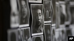FILE - Portraits of victims of the June 4, 1989 bloodshed are displayed at the June 4 Memorial Museum run by pro-democracy activists in Hong Kong.