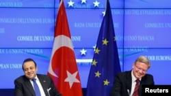 FILE-Turkey's European Affairs Minister Egemen Bagis (L) and European Enlargement Commissioner Stefan Fuele after EU-Turkey accession talks, Brussels, Nov. 5, 2013.