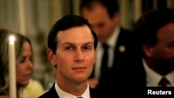 FILE - White House senior adviser Jared Kushner listens as U.S. President Donald Trump speaks at a dinner to honor evangelical leadership in the State Dining Room at the White House in Washington, Aug. 27, 2018.