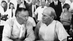 "Clarence Darrow, left, and William Jennings Bryan speak with each other at the ""monkey trial"" in Dayton, Tenn. in 1925."