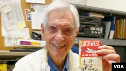 """Irwin """"Sonny"""" Fox holds his airline ticket to Tokyo from 1952, March 29, 2015. (VOA / M. O'Sullivan)"""