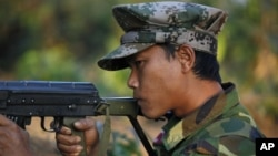 Kachin soldier mans a frontline position, facing off against Burmese government troops about 15 kilometers (9 miles) from the headquarters of the Kachin Independence Organization, in Laiza, Feb 13, 2012.