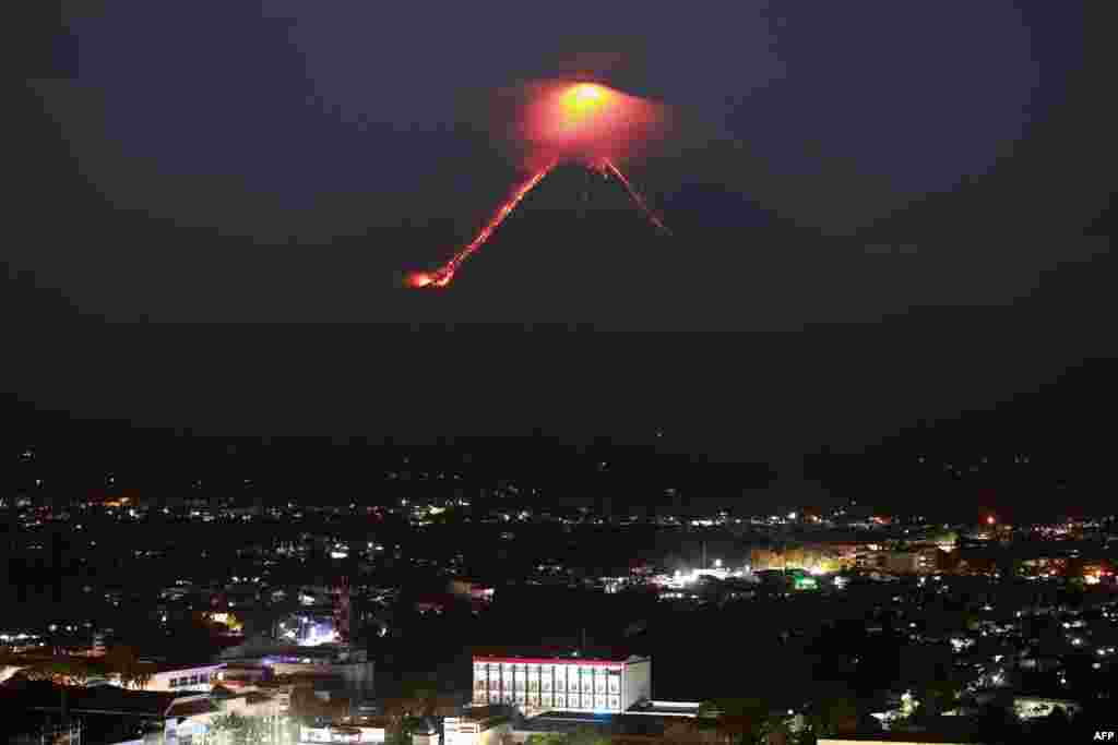 Lava from Mayon volcano is seen as it erupts in Legazpi. The Philippines raised the alert level for the country's most active volcano twice in 24 hours, meaning that a hazardous eruption is possible within days.