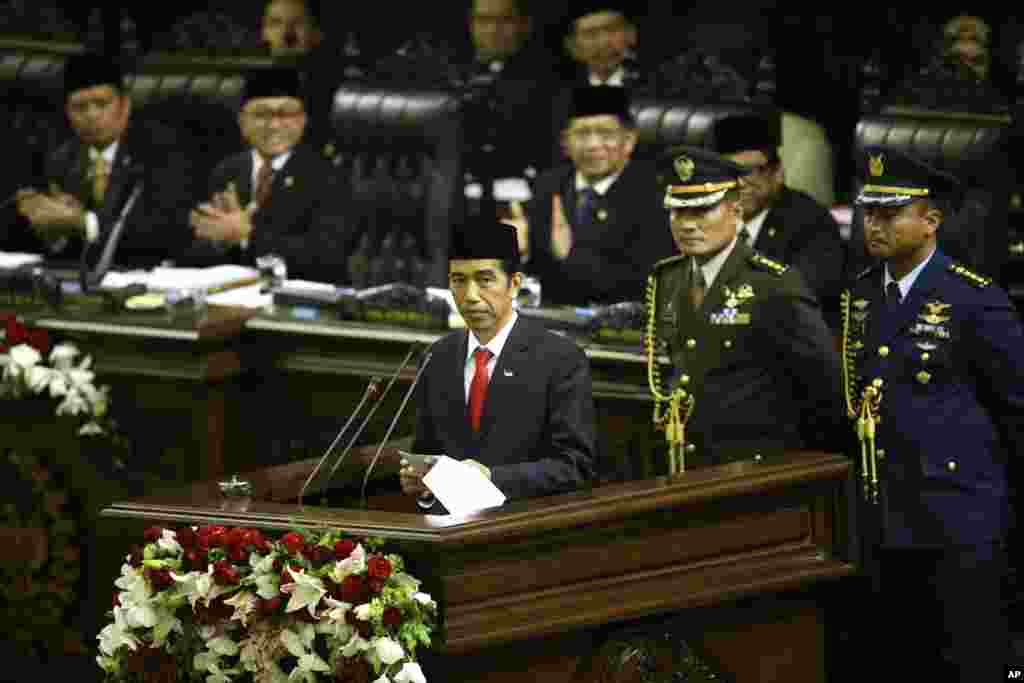 Indonesian President Joko Widodo delivers his inaugural speech as the country's seventh president at the parliament building in Jakarta, Indonesia, Oct. 20, 2014.