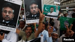 FILE - Supporters of former President Pervez Musharraf, head of the All Pakistan Muslim League (APML) political party, chant slogans during a protest demanding to remove his name from exit control list (ECL), so he can travel abroad to visit his ailing mother, in Karachi.