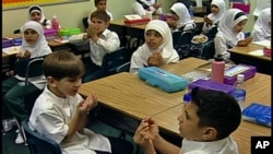 FILE - While many U.S. youngsters study foreign languages, such as Arabic at the Muslim Youth Academy in Dearborn, Michigan, at home plenty of them speak languages other than English.