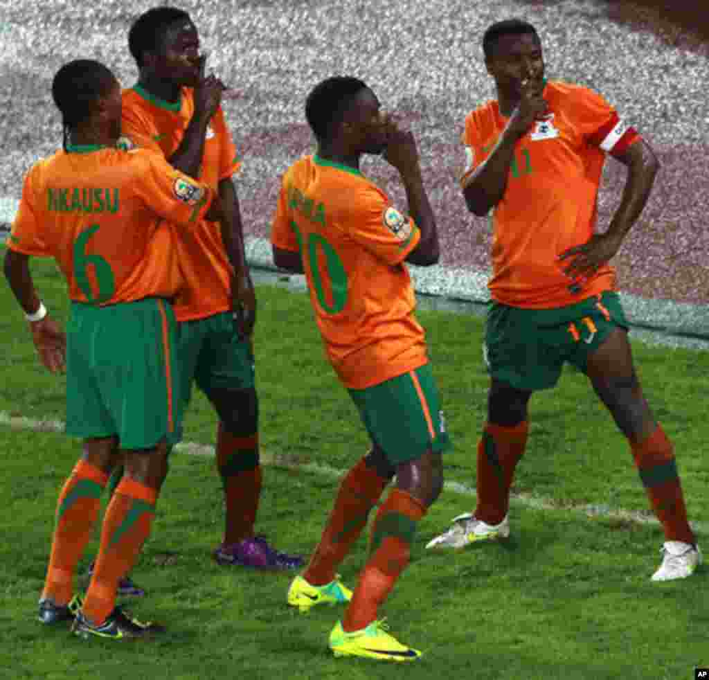 "Zambia's Katongo celebrates with his team after scoring a goal against Libya during their African Nations Cup Group A soccer match at Estadio de Bata ""Bata Stadium"", in Bata"
