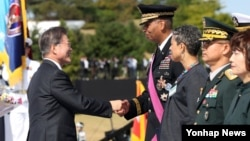 South Korean President Moon Jae-in awarded Vincent Brooks, Commander-in-Chief of ROK-US Combined Forces, during a celebration to mark the 69th anniversary of Korea Armed Forces Day, in Pyeongtaek, South Korea, September 28, 2017.