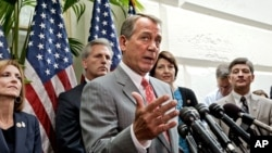As Congress returns to work following the July 4th break and the Supreme Court decision to uphold President Obama's health care law, House Speaker John Boehner of Ohio, center, and other GOP House leaders face reporters after a closed-door political strat