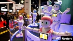FILE - Avatarmind's iPal Smart AI Robots, designed to be companions for children and elderly, perform calisthenics during the 2018 CES in Las Vegas, Nevada, Jan. 9, 2018.