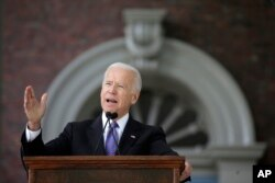 FILE - Former vice president Joe Biden speaks at Harvard University in Cambridge, Massachusetts, May 24, 2017.