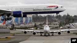A British Airways jet flies overhead on landing in Everett, Washington. (file photo)