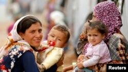 Người Kurd tị nạn từ thị trấn Kobani tại tị nạn ở thị trấn đông nam của Thổ Nhĩ Kỳ.
