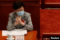 Hong Kong Chief Executive Carrie Lam wearing a face mask following the coronavirus disease (COVID-19) outbreak attends the opening session of the National People's Congress (NPC) at the Great Hall of the People in Beijing, China May 22, 2020