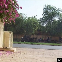 Soldiers stand guard by Niamey's national hospital, Niger, during a coup attempt against President Mamadou Tandja on 18 Feb. 2010