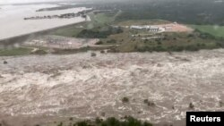An aerial view shows flooding along Lake Lyndon B. Johnson dam in Llano county, Texas, U.S., Oct. 16, 2018, in this still image from video obtained from social media.