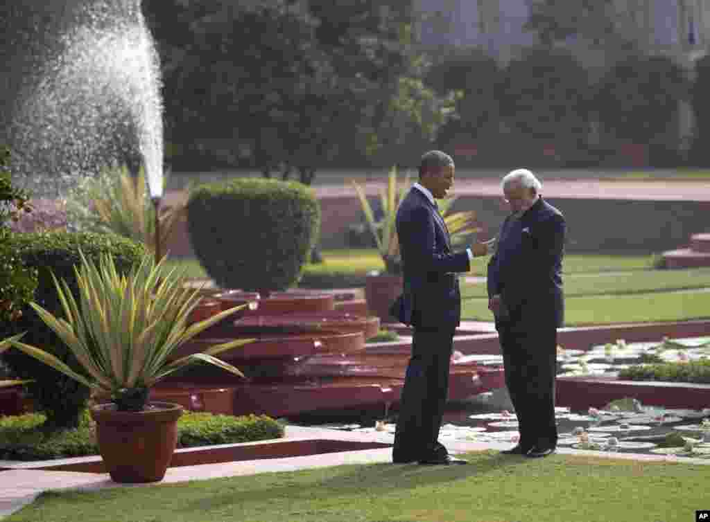 President Barack Obama and Indian Prime Minister Narendra Modi talk in the gardens of the Hyderabad House in New Delhi, Jan. 25, 2015.