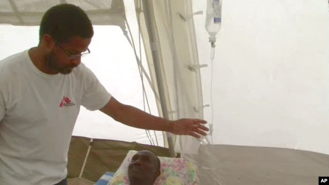 Nigerian-born Dr. Chibuzo Okonta with Doctors Without Borders attends to a patient in Port-au-Prince
