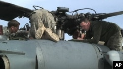 US Air Force crews prepare their helicopters at Bagram Air Base