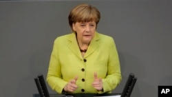 German Chancellor Angela Merkel delivers a declaration about the European Union and an Eastern Partnership with former Soviet Republics at the German parliament Bundestag, in Berlin, Germany, May 21, 2015.