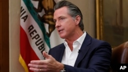 In this file photo taken on Oct. 8, 2019, California Gov. Gavin Newsom gestures during an interview in Sacramento, Calif.