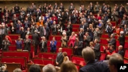 FILE - Lawmakers are seen in France's lower house of Parliament, in Paris.
