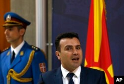 FILE - Macedonian Prime Minister Zoran Zaev speaks during a press conference in Belgrade, Serbia, Nov. 21, 2017.